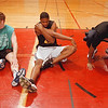 98/12/03 NCCC Basket 1 - Vino Wong Photo - NCCC players John Rhoat, John Walker and Ricky Latham stretch before a workout at Starpoint Central High Thursday.