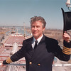 4/2/97 Welland Canal Opening - James Neiss Photo - Captain Charles (Bud) Robinson of the Marine Vessel Loius R. Desmarais, tips the top hat  he recieved for being the first vessel throught the Welland Canal marking the official opening of the 1997 season.