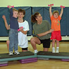 98/04/01 Healthy Kids Day *Dennis Stierer photo - YMCA aerobics instructor Jeannine Mullettand her son Craig, 4, on left are teaching the latest aerobics routine to Kristin Rivera and her daughter Emalee, 3.