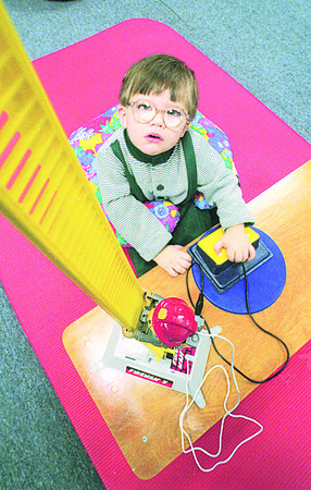 1/9/97 Toy Library 2 - James Neiss Photo - Aaron Wasson 22mos, plays with a fireman on a ladder.