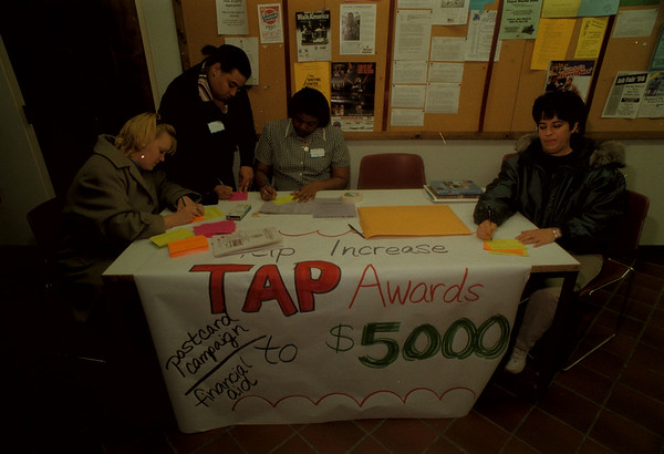 98/03/19 NU Financial Aid - James Neiss Photo - Students send notice to Albany, that they want an increase in TAP Awards. L-R are: Heather Lewis, a Business Marketing Student from NF, Joyceline St. Hill, a Criminal Justice Mjr from Brooklyn, Lori King, a Nursing Mjr from Brooklyn and Lynn D'amore, a social work mjr from NF, all fill out postcards to be sent to Albany.
