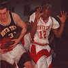 2/19/97-- power cats 1-- Takaaki Iwabu photo-- Brandon Jones of Hutch Tech, left, grabbs a rebound against NF Mark Profit.