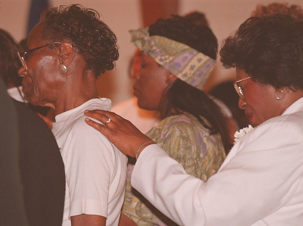 4/20/97--PRAYER/ST.JOHNS AME--DAN CAPPELLAZZO PHOTO--SHELLY WALKER, A MEMBER OF ST JOHN'S AME, PRAYS WITH FELLOW CHURCH GOER CORA BELL AT A SERVICE DEDICATED TO WOMAN AT ST JOHN AME ON CENTER STREET.<br /> <br /> LOCAL NEWS