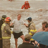 98/03/08--Polar Bear 3--Takaaki Iwabu photo-- Firefighters assist some of the swimmers who stumble on the shore as they come out from the water during the Sunday's Polar Bear Swim at Olcott Beach. Photographed is Steve Dickinson of Tonawanda. (Grapevine Photo)