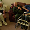 98/01/27--NURSING HOME--DAN CAPPELLAZZO PHOTO--JOHN HANNON, OF CHEETOWAGA, SHARES A LAUGH WITH HIS 76-YR-OLD FATHER, JOHN HANNON, AS HIS MOTHER DOROTHY HANNON, 75, WATCHES TV AT MOUNT ST MARY'S NURSING HOME, MAIN  STREET, NF.<br /> <br /> LOCAL