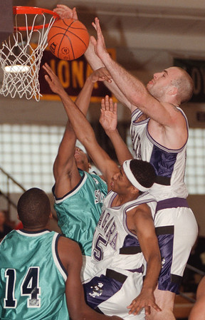 98/02/15--NU HOOPS/COLOR--DAN CAPPELLAZZO  PHOTO--NU FORWARD MIKE PIWERKA GOES UP HIGH TO TIP A REBOUND IN AFTER A SHOT BY TEAMATE AKBAR WAHEED IN FIRST QUARTER ACTION AGAINST ST PETER'S COLLEGE.<br /> <br /> SP