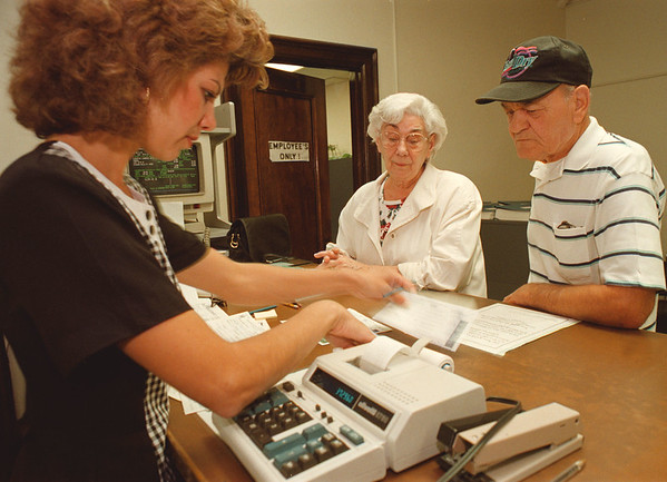 97/10/07--STAR EXEMPTION--DAN CAPPELLAZZO PHOTO--TERESA AND LAWRENCE SCZENIAK JR. COMPLETE THE STAR EXEMPTION PAPER WORK AT CITY HALL WITH THE HELP OF  ASSESSOR DATA CLERK SANDY BOWMAN. THE TAX BREAK SAVES SENIORS ON THEIR SCHOOL TAX.<br /> <br /> 1A