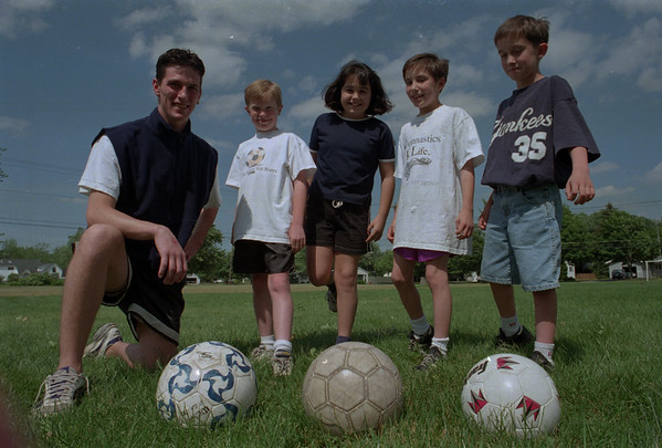 98/06/01 Summer Soccer *Dennis Stierer Photo - The Lockport Department Of Youth & Recreation is accepting registrations for its 1998 summer soccer program. From left getting ready to kick off are Director, J.R. Luskin and students Chris Holmes; Mollie Brown; Katy Graff; and Bobvby Graff.