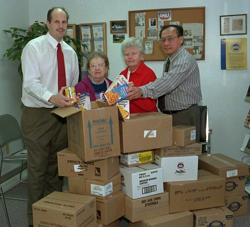 98/12/01 Middleport Food   *Dennis Stierer Photo<br /> The Middleport Food Pantry received a very nice donation from local Dentists Dr. Todd Parlato (left) and Dr. Steve Gouw (right). The ladies in the middle represent the Food Pantry:  Charlotte Brown and Betty Bridge.