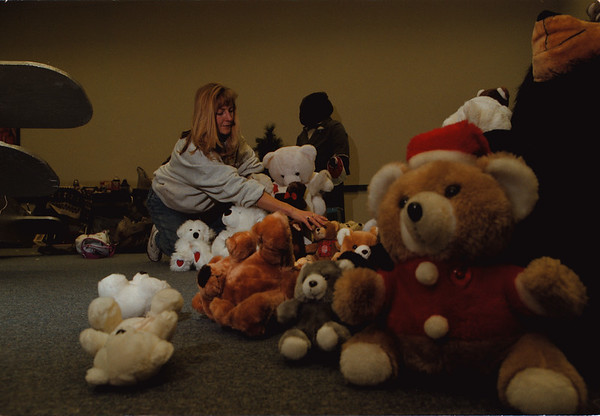 98/11/04 Festival of Lights - Vino Wong Photo - Kathy Kristich of Buffalo sets up one of the rooms with a variety of teddy bears as she prepares for the Festival of Lights come November 21st. Kristich is a freelance artistic designer working with Litetrix.