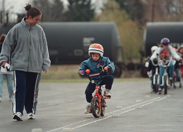 5/17/97-- Bike Rodeo, G--Takaaki Iwabu photo-- Jacob Luzak, 5, keeps his bicycle's balance as he participates in Bike Rodeo with other area children at Town of Niagara Saturday. Checking his performacne is Melanie Millette. <br /> <br /> grapevine photo, bw