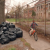 5/5/97--CLEVELAND SCHOOL CLEAN UP--DAN CAPPELAZZO PHOTO--7-YR-OLD TEREL SMITH, WHO LIVES ACROOS THE STREET FROM THE ABANDON SCHOOL, RIDES BY  GARBAGE BAGS FROM A VOLUNTEER CLREAN UP AT THE SCHOOL YARD ON 12TH AND CLEVELAND. SMITH SAID HE WAS HAPPY THEY CLEANED UP, NOW HIS FRIENDS  AND HE CAN PLAY IN THE SCHOOL YARD, NOT HAVING TO WORRY ABOUT GALSS.<br /> <br /> OPINIOP