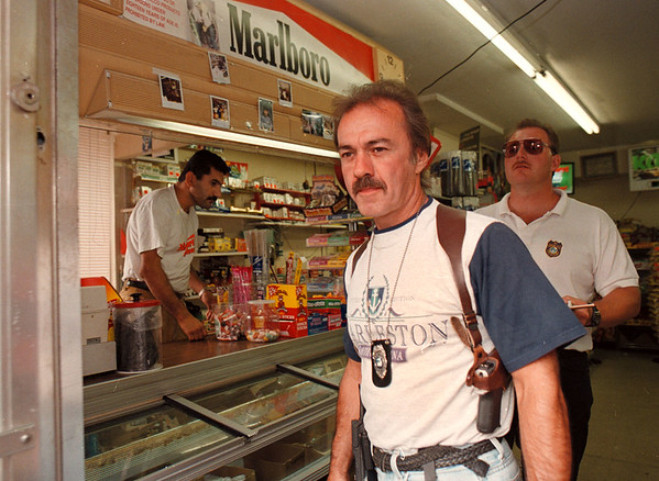 7/1/97--TEEN BOOZE CRACKDOWN--DAN CAPPELLAZZO PHOTO--DETECTIVE JOE MORRISON AND DETECTIVE JOE COWELL LEAVE THE MAIN MINI MART(CORNER OF MAIN AND NIAGARA AVE.) AFTER BUSTING MOHAMAD ZIDAN FOR SELLING BEER TO MINORS.<br /> <br /> 1A