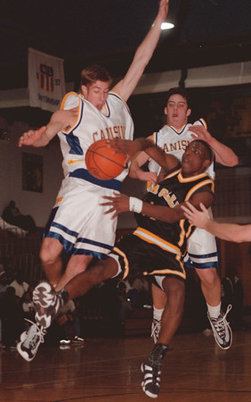 97/12/06-- LaSalle/Canisius--Takaaki Iwabu photo-- LaSalle HS Caston Binger's pass was blocked by Canisius HS Chris Barry, left, and Frank Fusco. <br /> <br /> sports, color, Sunday