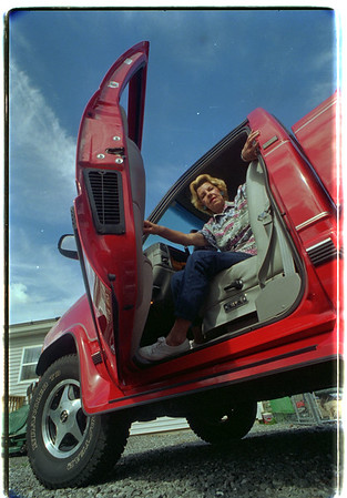 97/08/06/ Pat Harms Truck - James Neiss Photo - Pat  Harms and her truck. Town of Niagara.