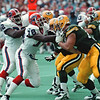 97/08/27--BILLS DEF LINE--DAN CAPPELLAZZO PHOTO--BILLS D-LINE BRUCE SMITH AND  TED WASHINGTON PRESS THE O-LINE OF THE GREEN BAY PACKERS.<br /> <br /> TAB
