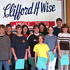 98/05/11 March Students - March students of the month at Wise Middle school are Stevie Patterson (very front in  yellow); 1st row (ltoR) Kevin Eick; Hope Secore; Sara Page; Lindsey Bennett; Nicole Poler; back row (LtoR) Aaron Phillips; Dan Berry; Shannon Morehouse; Rhonda Wright; Jevon Cecchini; and pricipal William Herley.