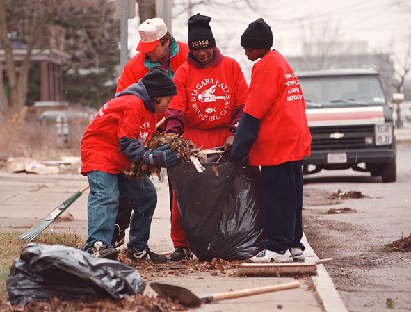 3/2/97--MAIN STREET CLEAN UP--DAN CAPPELLAZZO PHOTO--G.M. ROGER SPURBACK (WHITE HAT) AND MEMBERS OF THE N.F. WRESTLING CLUB (LTOR) DEXTER HARRIS, MARCUS HENDERSON (CENTER) AND JOHN SMITH BAG TRASH  ON LINCOLN PL. JUST OFF MAIN ST. DURING A CLEAN OF THE FILTHY AREA OF TOWN BY THE CLUB.''
