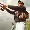 97/10/15-- fishing --Takaaki Iwabu photo-- Tom Zarrillo casts a fishing pole to Niagara River at Lynch Park Wednesday as he went out for fishing with his friend Chris Prebite, back. <br /> <br /> grapevine photo