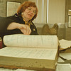 98/02/25-- history --Takaaki Iwabu photo-- Maureen Fennie, manager at local history department of Niagara Falls Public Library, goes through one of history books at Library. (For Glynn's topic on history dept of Library... ) <br /> <br /> 1A, Thursday, color