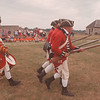97/08/15 Kings Regiment Drummer - James Neiss Photo - Jonathan Demler, a drummer in the Kings Regiment at Old Fort Niagara, signals the charge as visitors look on.