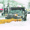 1/10/97 Snow Plowing - James Neiss Photo - Mike Dell of NF plows the lot of a gas station at the corner of Pine and Main.<br />                   Said he can be reached at 297-1794