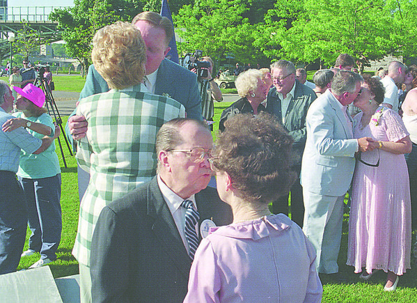 6/14/97-- renewing vow--Takaaki Iwabu photo-- Couples exchange a kiss duirng the Niagara's Wedding Vow Renewal ceremony at Prospect Point Sunday. One the stage are Mayor Jim and Eva Galie, back and Tommy and Liz Cottonaro (they appeared movie Wizard of Oz as Mayor of Munchkin Land). <br /> <br /> Sunday, local, color