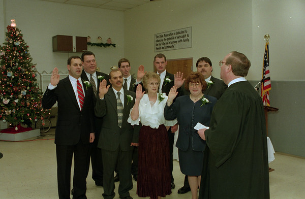 98/01/07 Common Council Oath*Dennis Stierer - The Common Council for the City of Lockport gets sworn in by Hon. John F. Batt, Family Court Judge. Th Common Council is from left front row: Jacob Michaels, 4th ward; Greg Wik, 8th ward; Emma Cavalieri, 1st ward; Constance Beccue, 3rd ward; back row: Mark Dudkowski, 6th ward; Sean Smith, 2nd ward; Brian Keleher, 5th ward; and Michael Tucker, 7th ward and council president.