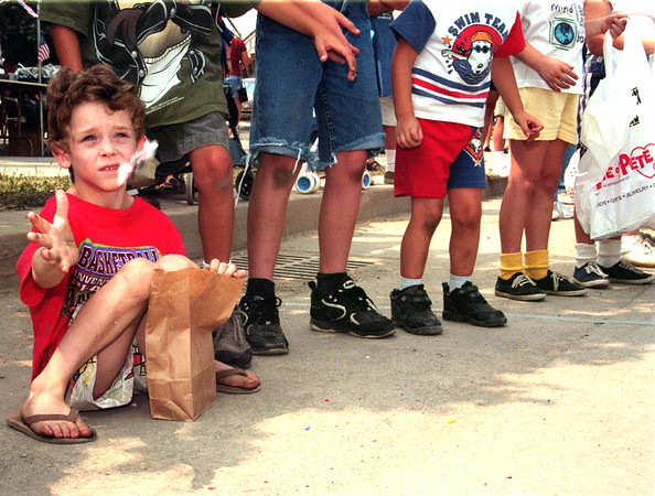 98/08/15 Kid Parade-Rachel Naber Photo-Marshall Kelkenberg, age 7 of Newfane catches candy thrown from the parade floats at the Newfane Kids Parade on Main Street.