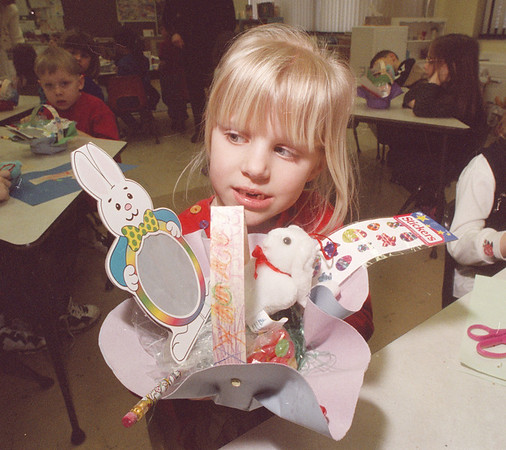 """3/21/97 Holliday Basket - James Neiss Photo - James Neiss PHoto - Amber Baker 6yrs in KG at LewPort South Elem, holds her """"spring basket"""" she made in class filled with bunnies, eggs grass and more. She is a student in Mrs. Nardene Bradt's class."""