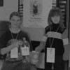 98/02/21 Collecting Telethon *Dennis Stierer photo - Adam Fletcher and Chelsea Castricone, 4 show the proper bottle and can along with the neck card that voluteers will be using during the telethon.