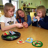 98/12/04 Making Ornaments *Dennis Stierer Photo <br /> Local students came to the Lee Whedon Library on Friday to make Christmas ornaments for the Holiday Craft Show. The twins, Holly and Felicia McQueen, 10 get some help from Suzanne McAllister, who is with the childrens services at the Library.
