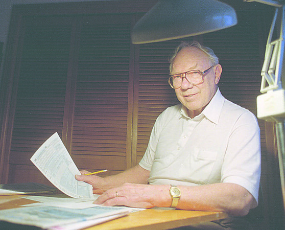 1/11/96--tax counselor--Takaaki Iwabu photo-- E. Ernest Beamer, a volunteer for Tax Counseling For Elderly, gets ready for another tax-reporting season at his home in Lockport. <br /> <br /> 1A, Sunday