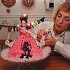 4/10/97--PARTY GIRL/RUSH--DAN CAPPELLAZZO PHOTO--CAKE MAKER AND PARTY ORGANIZER DEBBIE RUSH, OF AMHERST PUTS THE FINISHING TOUCHES ON A CHILDS CAKE.<br /> <br /> FEATURE