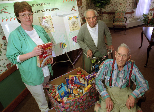 98/04/03-- easter food --Takaaki Iwabu photo-- Staff and residents at Crestwood Health Care Center are working on its Easter Food Drive for local  Salvation Army. From left, Martha Turner RN of Wheatfield, Patrick C. Gerbasi, LaSalle, and Albert J. Marquis, Wheatfield. <br /> <br /> tmc photo