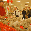 "98/02/21-- t. bear --Takaaki Iwabu photo-- Ben Gregory, left,  store team leader at TARGET on Niagara Falls Blvd, pushes the cart full of teddy bears as Nick Vilardo, Cheif of Fire Prevention, looks on.  TARGET gave away teddy bears to Niagara Falls Fire Department to help comfort children in emergencies as part of the store's ""Helping Hug"" program. <br /> <br /> bw, Sunday, local"