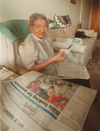 97/09/19 Sports Fan - James Neiss Photo - Josephine Carlo, 87yrs, cuts out the daily game schedual every day so she can tune in on her favorate game.