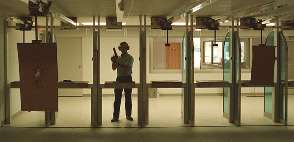97/09/03--GUN RANGE/NFB--DAN CAPPELLAZZO PHOTO--DENNIS DEASY, OF THE NIAGARA GUN RANGE, LOOKS DOWN RANGE AT A TARGET. THIS PHOTO WAS TAKEN TO SHOW THE RANGE, AT NO TIME ARE PEOPLE PERMITTED DOWN RANGE. THE NGR PRACTICES GUN SAFTY.<br /> <br /> 1A FRIDAY