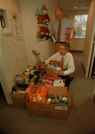 97/12/10 Food Drive - James Neiss Photo - Standing, John R. Whiteman, DDS and Salvatore J. Manente, DDS., M.S. kneeling, asked patients to donate food for the needy. They will be personally adding to the donations and giving it all to local charities. They are an OrthodonticÕs clinic... see attached business card.
