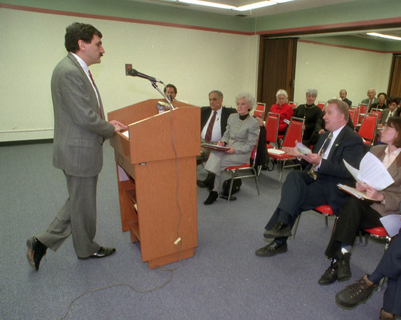 97/01/15 Hospital 2 - James Neiss Photo - Angelo G. Calbone, president and chief ececutive officer of Health System of Niagara listens to Mayor James C. Galie as he speaks his mind about the consolodation durring a meeting between hospital and public officials.