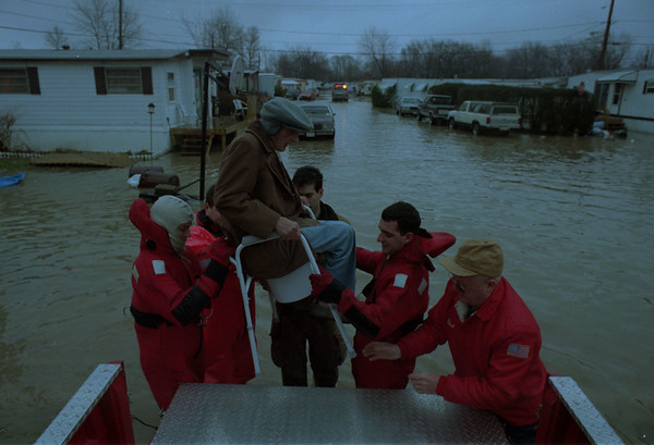 98/01/08--CAYUGA FLOOD--DAN CAPPELLAZZO PHOTO--RESCUE WORKERS LOAD 96-YR-OLD ROMAN BEITER, 560 D STREET, ON TO A EMERGENCY VEHICLE DURING AT HIS FLOODED TRAILER AT CAYUGA VILLAGE.<br /> <br /> 1A