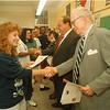97/08/27 EPIC Graduation - James Neiss Photo - Cherie Lindner of Lockport get her diploma from EPIC founder robert Wilson who made a surprise appearance.<br /> <br /> EPIC  - Every Person Influences Children<br /> Pat Bradley Story