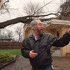 4/29/97-- windy weather-- Takaaki Iwabu photo-- Phil Conley of 732 Park Place finds his home damaged by a tree which was down by Thursday's high wind. (There was no injury.)<br /> <br /> local, Friday, bw