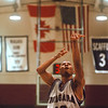 98/12/05 NU vs Ionia-Rachel Naber Photo-Jeremiah Johnson of Niagara University takes a foul shot in the game against Ionia at Niagara University.