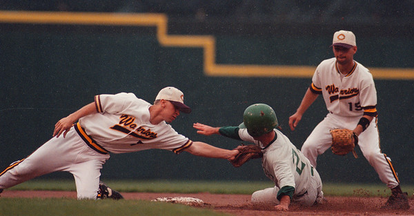 5/31/97-- LP baseball 2--tak photo-- Lew-Port HS Nick Morreale slides into the second base on his attempt to a steal. Tagging Morreale is Mark Bednasz of Cheektowaga. <br /> <br /> sunday