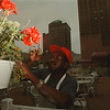 98/08/06-- flower in city--Takaaki Iwabu photo-- Greg Wynn, an employee at Legends Bar and Grill at Ramada Inn, takes care of the flower hanged at the RestaurantÕs patio. <br /> <br /> Grapevine photo