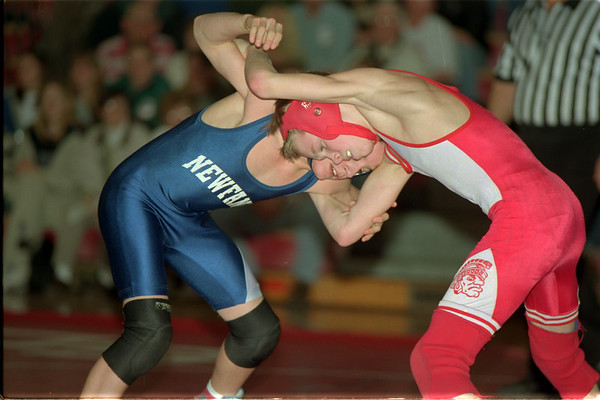 98/01/21 Wrestling 2 *Dennis Stierer photo - Ryan Needle from Newfane and Dave Heppner of Starpoint. Ryan Needle won the 103 class.