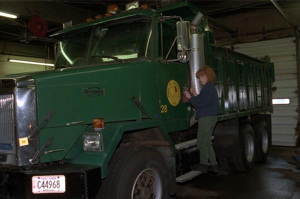 98/01/22 Carol Maham 2*Dennis Stierer photo - Carol Maham washes trucks at Hartland Public Works.