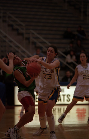 98/03/03 Lockport Victorious *Dennis Stierer photo - Chae Costello,#33 of Lockport and Mari Andrade,#33 of Jaamestown battle over a rebound.