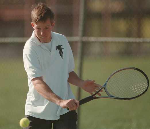 98/04/27--HS Tennis 1--Takaaki Iwabu photo-- Ted Sheehan, senior at Niagara-Wheatfield High School, returns a ball with a backhand during a match with Mattias Altmeyer of LaSalle High School. <br /> <br /> color, Sports, Tuesday